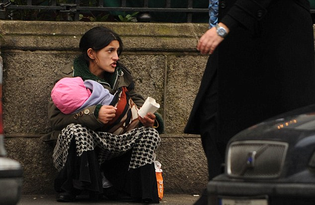 beggar street mother child